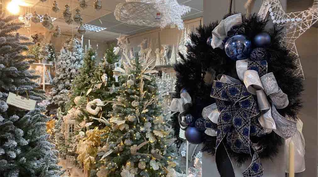 A Christmas wreath displayed in a Christmas shop