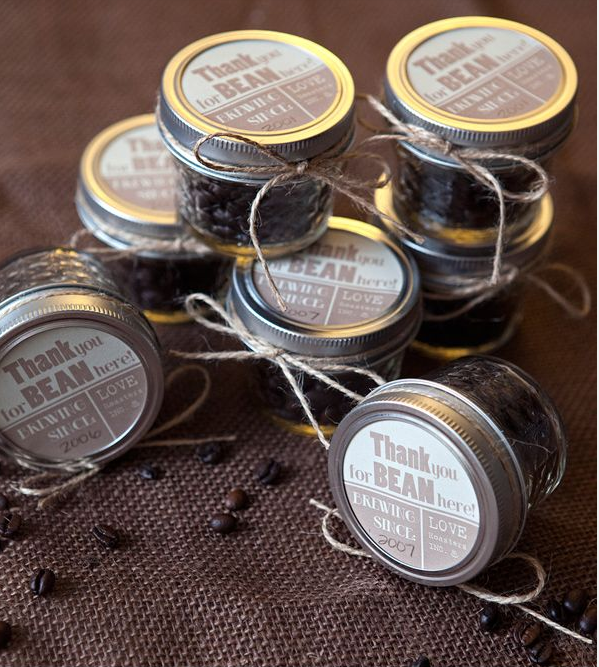 Small jars with coffee beans inside