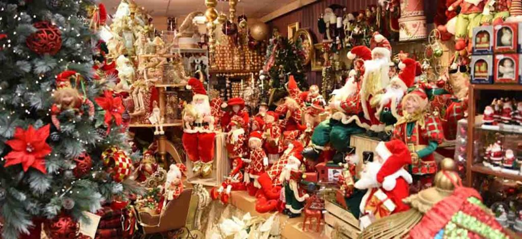 A Christmas shop filled with red and gold christmas decor