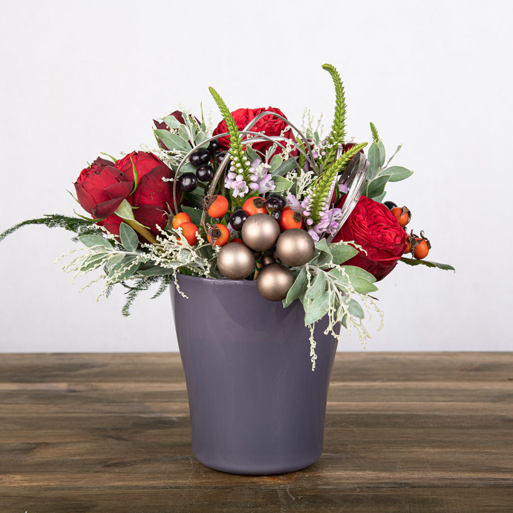 Mixed red florals in a nice blue vase part of the Nordic Bloom Collection.