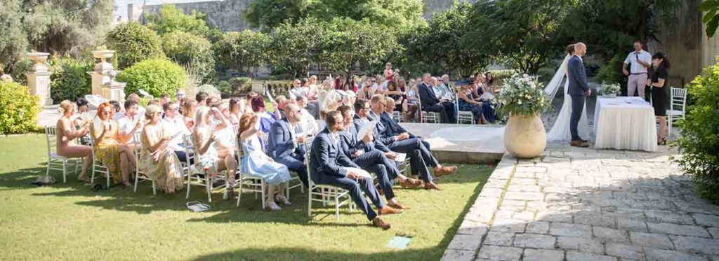 People sitting down during a civil ceremony